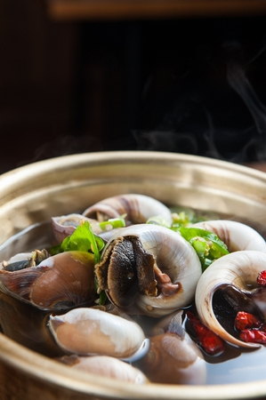 Photo for whelk soup in stainless pot - Royalty Free Image