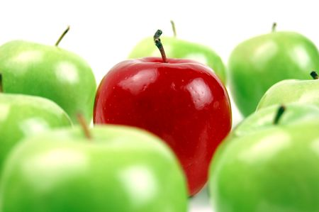 Photo for A red apple stands out as unique among a bunch of green apples.  Shallow DOF. - Royalty Free Image