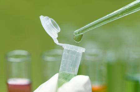 Foto de Dropping chemical in a sample tube from a dropper - Imagen libre de derechos