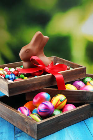 Photo for Chocolate Easter eggs and chocolate bunny and colorful sweets - Royalty Free Image