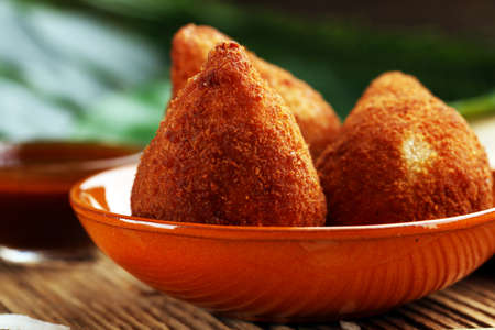 Photo for Coxinha street food. Brazilian Chicken Coxinha over rustic background - Royalty Free Image