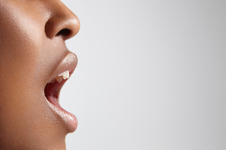 Photo for profile of a black woman with open mouth - Royalty Free Image