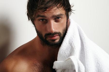 Foto de portrait of a beauty man with a beard and towel - Imagen libre de derechos