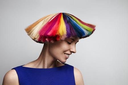 Photo pour woman shake her rainbow color hair - image libre de droit