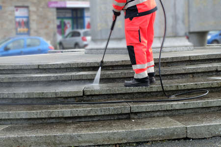 Foto per Worker cleaning the stair - Immagine Royalty Free