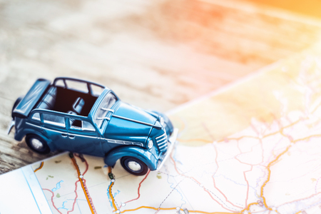 Foto de retro cabrio car on the map, tourism concept - Imagen libre de derechos