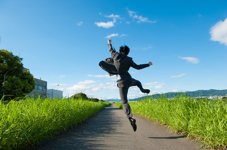 Foto de From behind the businessman to jump - Imagen libre de derechos