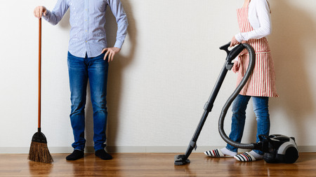 Photo for Men and women cleaning the room - Royalty Free Image
