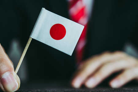 Photo for Businessman and national flag - Royalty Free Image
