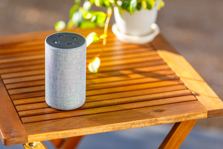 Photo for Wooden tables and smart speakers - Royalty Free Image