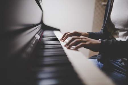 Photo for Piano and human hands - Royalty Free Image