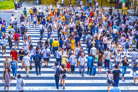 Foto de Osaka, Japan -  12 August 2018 - People walking crosswalk at Umeda in Osaka,Japan. - Imagen libre de derechos