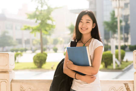 Photo for Portrait of a Asian college student at campus - Royalty Free Image