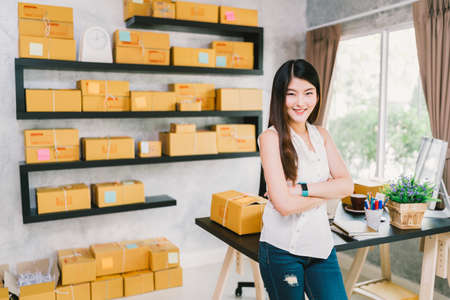 Photo pour Young Asian small business owner at home office, online marketing packaging and delivery scene, startup SME entrepreneur or freelance woman working at home concept - image libre de droit