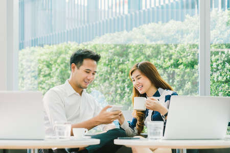 Photo for Young Asian couple at a coffee shop. - Royalty Free Image
