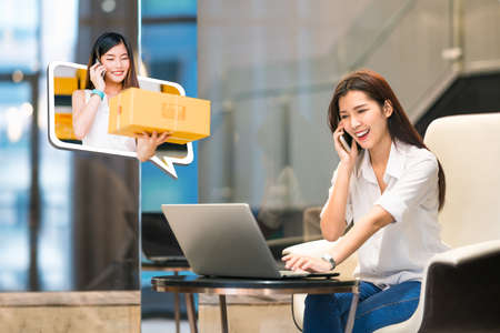 Photo pour Beautiful Asian girl shop online using phone call with female small business owner delivering parcel box. Internet shopping lifestyle, Ecommerce, shipment service, SME sale promotion advertise concept - image libre de droit