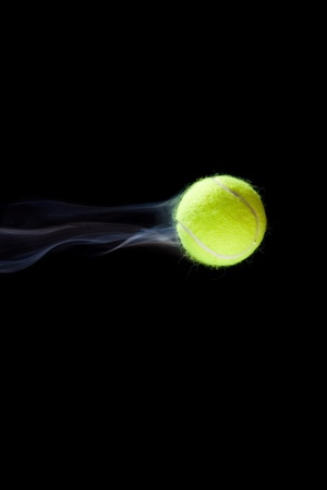 Fast moving tennis ball simulated with smoke.