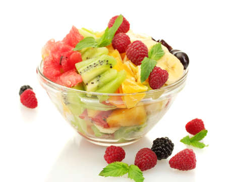 Foto de fresh fruits salad in bowl  and berries, isolated on white - Imagen libre de derechos