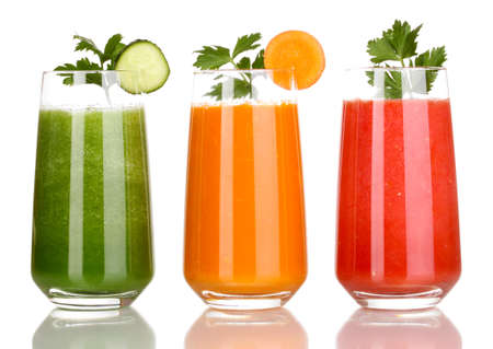 Foto de Fresh vegetable juices isolated on white - Imagen libre de derechos