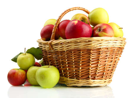 Photo for juicy apples with green leaves in basket, isolated on white - Royalty Free Image