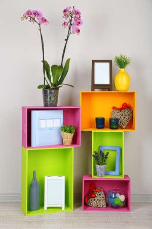 Foto de Beautiful colorful shelves with different home related objects - Imagen libre de derechos