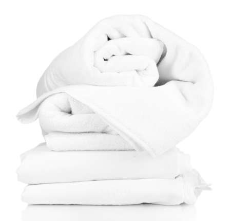 Photo pour Stack of rumpled bedding sheets isolated on white - image libre de droit