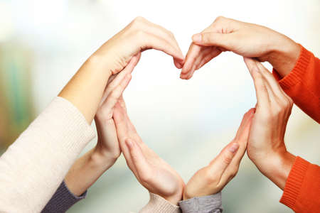 Foto de Human hands in heart shape on bright background - Imagen libre de derechos