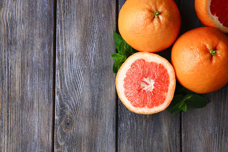 Photo for Ripe grapefruits on wooden background - Royalty Free Image