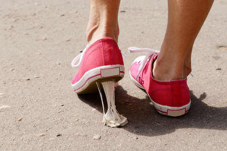 Photo for Foot stuck into chewing gum on street - Royalty Free Image