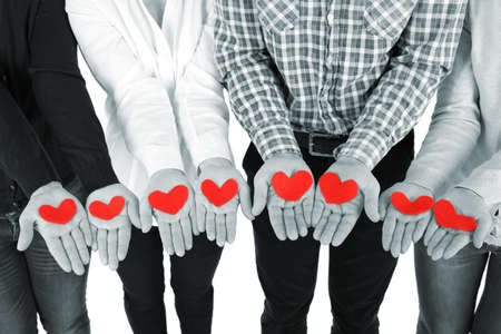 Photo pour Hands with hearts, close up - image libre de droit