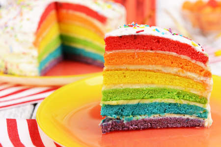 Photo pour Delicious rainbow cake on plate on table on bright background - image libre de droit