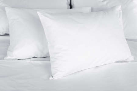 Photo pour White pillows on bed close up - image libre de droit