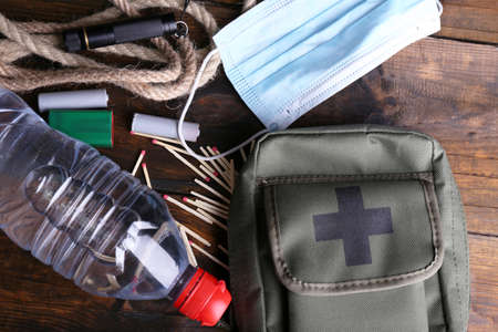 Foto de Emergency preparation equipment on wooden background - Imagen libre de derechos