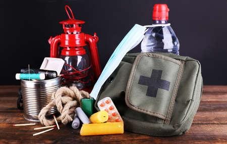 Foto de Emergency preparation equipment on wooden table, on dark background - Imagen libre de derechos