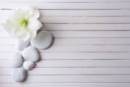 Photo pour Spa stones on wooden table - image libre de droit