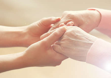Foto de Helping hands, care for the elderly concept - Imagen libre de derechos