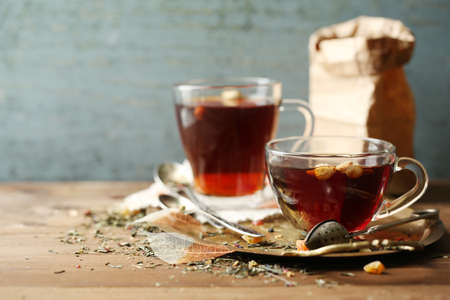 Photo for Beautiful vintage composition with herbal tea, on wooden table - Royalty Free Image