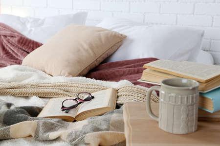Photo pour Book and glasses on bed close-up - image libre de droit