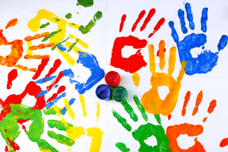 Photo pour Hand prints of paint with paint on white background - image libre de droit