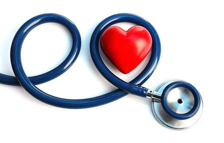 Foto de Stethoscope with heart on light background - Imagen libre de derechos