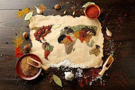 Foto de Map of world made from different kinds of spices on wooden background - Imagen libre de derechos