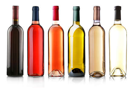 Photo pour Wine bottles in row isolated on white - image libre de droit
