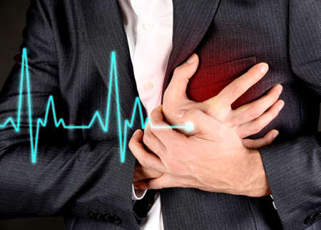 Foto per Man having chest pain - heart attack - Immagine Royalty Free