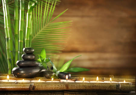 Photo for Spa stones, candles on wooden background - Royalty Free Image