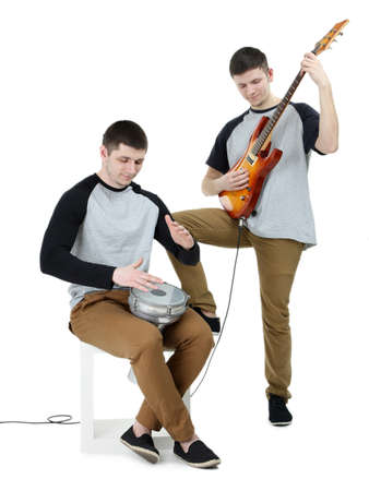 Photo pour Two handsome young men with musical instruments isolated on white - image libre de droit