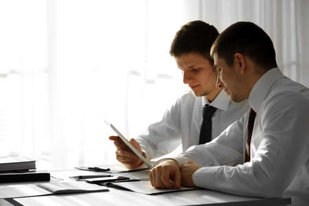 Photo for Two handsome businessmen working in office - Royalty Free Image