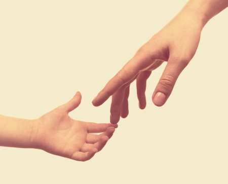 Foto de Child and mother hands on light background - Imagen libre de derechos