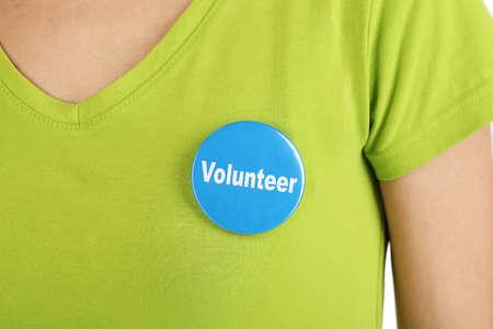 Foto de Round volunteer button on shirt of girl - Imagen libre de derechos
