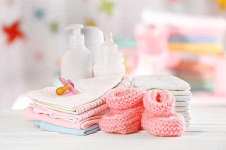 Photo pour Baby accessories on table on light background - image libre de droit