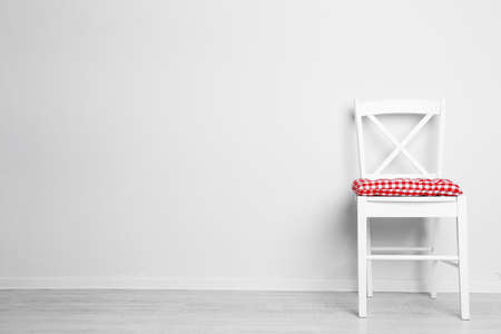 Photo pour Modern chair with pillow on white wall background - image libre de droit